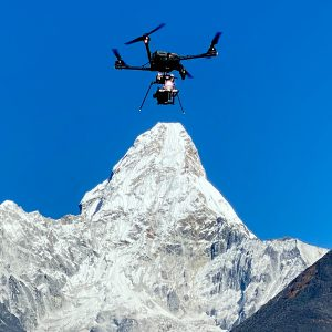 drone flying at high altitude by Ama Dablam